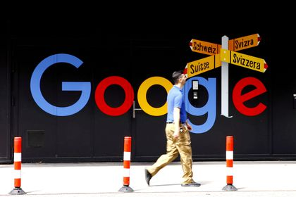 FILE PHOTO: A man walks past a logo of Alphabet Inc's Google in front of at an office building in Zurich, Switzerland July 1, 2020.   REUTERS/Arnd Wiegmann/File Photo