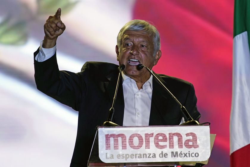 FILE - In this June 27, 2018 file photo, then presidential candidate Andres Manuel Lopez Obrador, of the MORENA party, holds his closing campaign rally at Azteca stadium in Mexico City. Mexico's three main opposition parties have announced on Tuesday, Dec. 22, 2020, an odd alliance to try to wrest control of the lower house of congress from President Andres Manuel Lopez Obrador's Morena party in elections set for June 6. (AP Photo/Ramon Espinosa, File)
