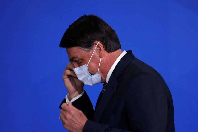 Brazil's President Jair Bolsonaro reacts during a ceremony to launch a program to expand access to credit at the Planalto Palace in Brasilia
