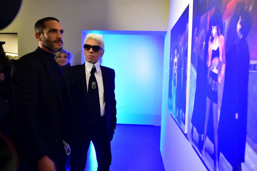 """Designer Karl Lagerfeld and Sébastien Jondeau during the launching of his exhibition """"Karl Lagerfeld, A Visual journey"""" in Paris."""