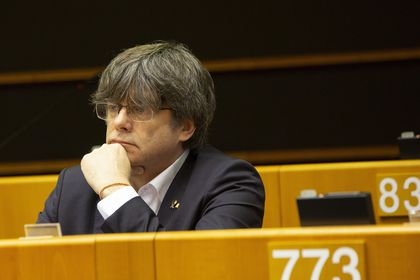 Catalonia's former regional president and MEP Carles Puigdemont listens during a session in the Plenary chamber of the European Parliament in Brussels, Tuesday, March 10, 2020. EU lawmakers were due to take part in a drastically shortened European parliamentary session in Brussels amid concern about the spread of coronavirus. EU leaders were also due to hold a videoconference Tuesday to coordinate efforts across the 27-nation bloc to slow the disease down. (AP Photo/Virginia Mayo)