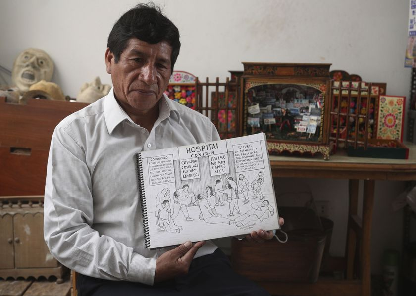 Edilberto Jimenez poses with one of his drawings at his home in San Juan de Lurigancho, on the outskirts of Lima, Peru, Thursday, May 20, 2021. Jimenez compiled in a book his interpretation of the sufferings that Peruvians have endured during the COVID pandemic that has caused a deepening economic crisis and has killed more than 66,000 people in the Andean country. (AP Photo/Martin Mejia)