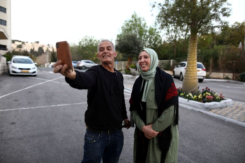 Iman Yassin Khatib, poised to become the first lawmaker in Israel's history to wear a hijab or head scarf, which she does as a Muslim, following results of her Arab Joint List party in Israel's election, takes a selfie with a friend in Nazareth