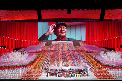A screen shows late Chinese leader Deng Xiaoping during a show commemorating the 100th anniversary of the founding of the Communist Party of China at the National Stadium in Beijing, China June 28, 2021. REUTERS/Thomas Peter