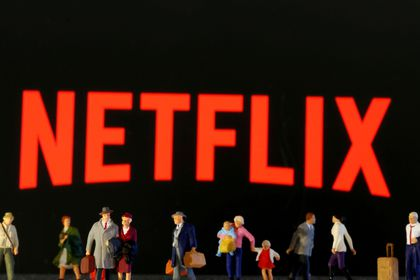 FILE PHOTO: Small toy figures are seen in front of displayed Netflix logo in this illustration taken March 19, 2020. REUTERS/Dado Ruvic/Illustration/File Photo