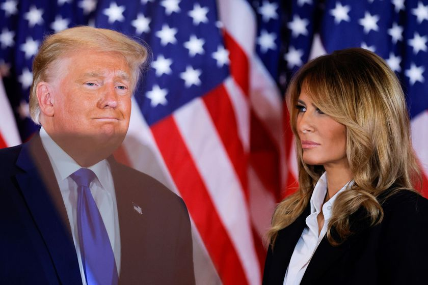 U.S. President Donald Trump accompanied by first lady Melania Trump reacts to early results from the 2020 U.S. presidential election in the East Room of the White House in Washington, U.S., November 4, 2020. REUTERS/Carlos Barria