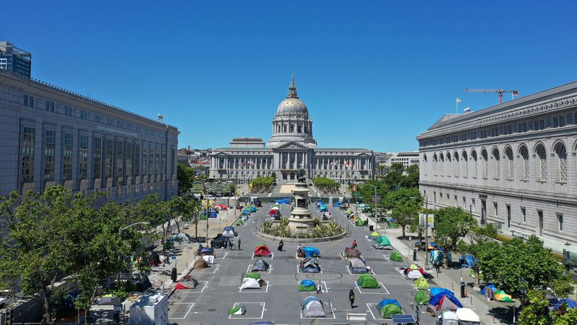 Tents are pitched using social distancing to help slow the spread of coronavirus disease (COVID-19) at a homeless encampment in a square next to city hall in San Francisco