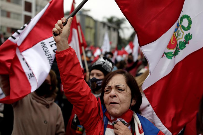 People participate in a protest against communism and Peru's new government led by President Pedro Castillo, a self-described Marxist-Leninist, in Lima, Peru August 1, 2021. REUTERS/Angela Ponce