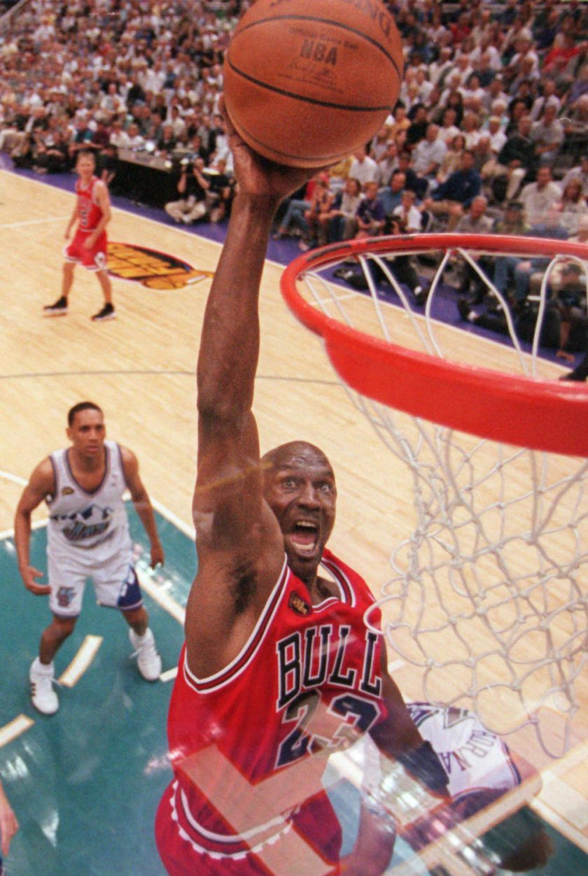 FOR USE WITH YEAREND STORIES -- Chicago Bulls' Michael Jordan goes to the basket in the third quarter as Utah Jazz's Howard Eisley looks on during Game 2 of the NBA Finals in Salt Lake City, in this June 5, 1998 photo. Jordan scored a team high 37 points as the Bulls defeated the Jazz 93-88, tying the best-of seven series 1-1. (AP Photo/Mark J. Terrill)