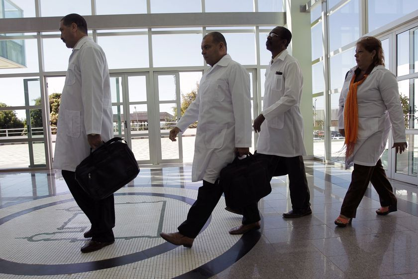 FILE - In this Aug. 26, 2013 file photo, Cuban doctors arrive for training before being assigned to work in impoverished areas where physicians and medical services are scarce, at the University of Brasilia in Brasilia, Brazil. A federal judge paved the way on Monday, Nov. 9, 2020, for a lawsuit against the Pan American Health Organization for its alleged role in the human trafficking of Cuban doctors to Brazil between 2013 and 2018 to be heard in the United States courts. (AP Photo/Eraldo Peres, File)