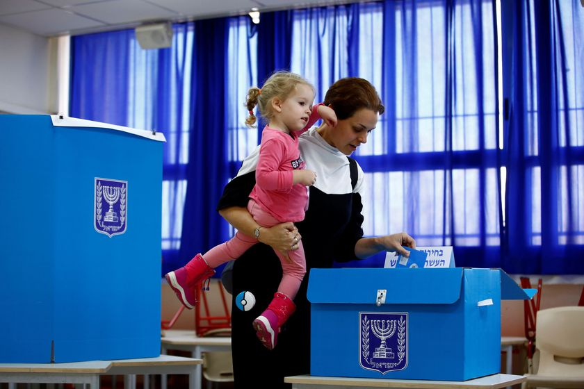 A woman casts her ballot as she votes in Israel's national election at a polling station in Tel Aviv, Israel