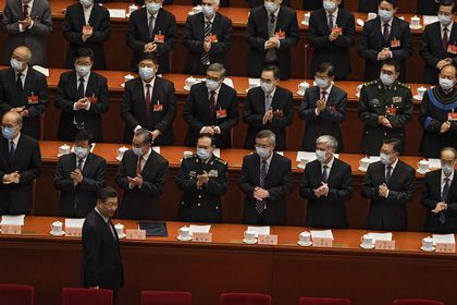 "FILE - In this March 4, 2021, file photo, delegates wearing face masks to help curb the spread of the coronavirus applaud as Chinese President Xi Jinping arrives for the opening session of Chinese People's Political Consultative Conference (CPPCC) at the Great Hall of the People in Beijing. The catchword ""rejuvenation"" has been tucked into the major speeches at China's biggest political event of the year, the meeting of its 3,000-member legislature. (AP Photo/Andy Wong, File)"