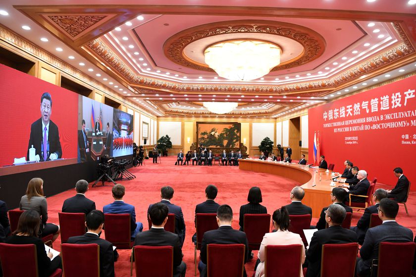 China's President Xi Jinping speaks with Russian President Vladimir Putin via a video link, from the Great Hall of the People in Beijing