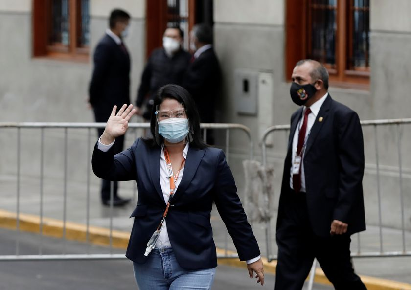 Peru's presidential candidate Keiko Fujimori waves as she arrives at the National Court of Tacna Avenue in Lima, Peru, June 21, 2021. REUTERS/Angela Ponce