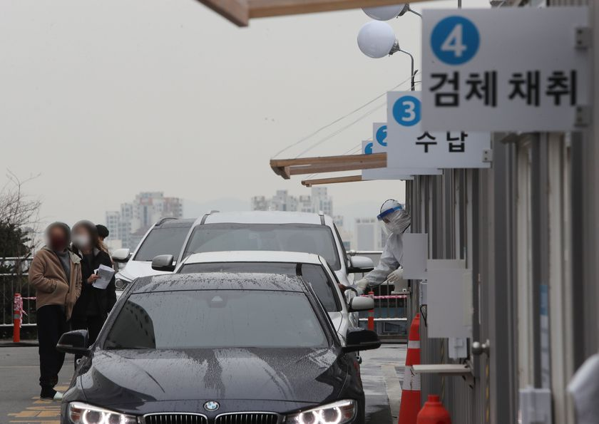 Cars wait in line at 'drive-through' virus testing center