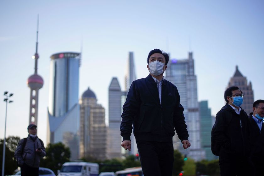 People wear protective face masks, following an outbreak of the novel coronavirus disease (COVID-19), at Lujiazui financial district in Shanghai