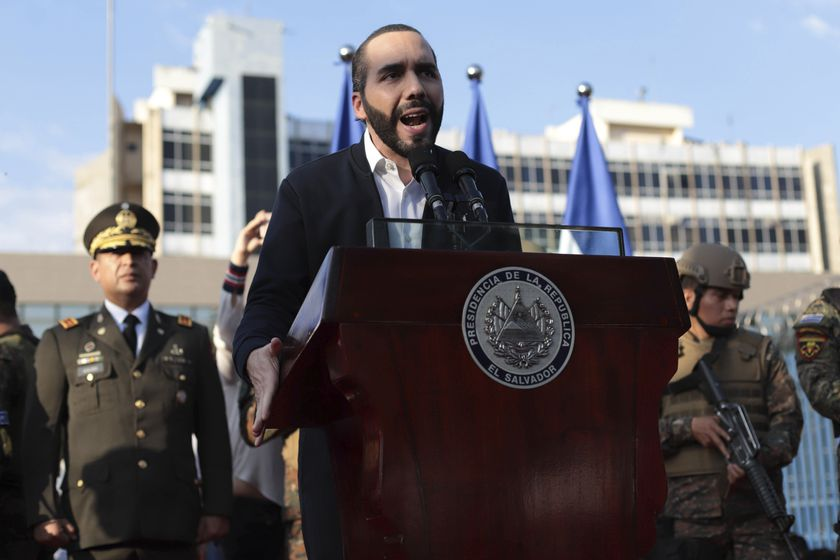 FILE - In this Feb. 9, 2020 file photo, El Salvador's President Nayib Bukele, accompanied by members of the armed forces, speaks to his supporters outside Congress in San Salvador, El Salvador. Bukele's party has swept all three main opposition parties during 2021's midterm elections, giving him a mandate to change the way politics are run in the central American country. (AP Photo/Salvador Melendez, File)