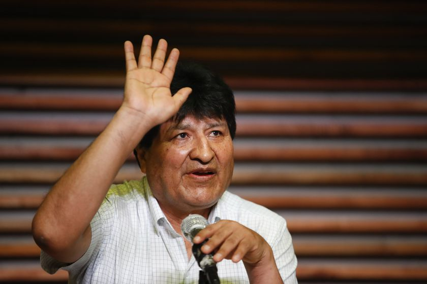 Former Bolivian President Evo Morales waves during a press conference in Buenos Aires, Argentina, one day after general elections in his home country, Monday, Oct. 19, 2020. Morales' party claimed victory in a presidential election that appeared to reject the right-wing policies of the interim government that took power in Bolivia after the leftist leader resigned and fled the country a year ago. (AP Photo/Natacha Pisarenko)