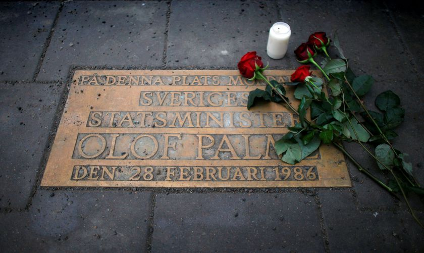 FILE PHOTO: Roses are laid on a plaque marking the location where Swedish Prime Minister Olof Palme was killed in Stockholm