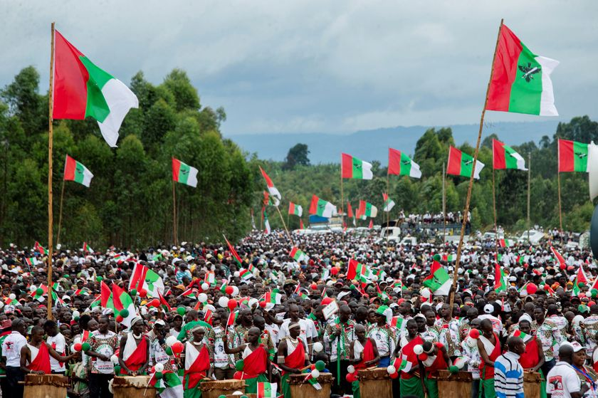 FILE PHOTO: Supporters of Burundi's ruling party, the National Council for the Defense of Democracy-Forces for the Defense of Democracy (CNDD-FDD), attend a campaign rally of their presidential candidate Evariste Ndayishimiye at the Bugendana Stadium
