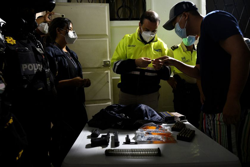 A policeman checks the ID of a man during a police operation to tackle COVID-19 restrictions violations, amid a rise in coronavirus disease cases and deaths, in Guayaquil, Ecuador May 1, 2021. Picture taken May 1, 2021.  REUTERS/Santiago Arcos