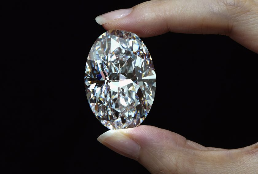 A 102.39 carat, D color, flawless diamond is displayed by a model at a Sotheby's auction room in Hong Kong Monday, Sept. 28, 2020. It is the first time that a diamond this size and caliber will be auctioned without reservations in history. (AP Photo/Vincent Yu)
