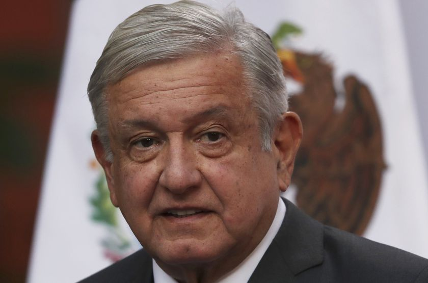 Mexican President Andres Manuel Lopez Obrador speaks during the commemoration of his second anniversary in office, at the National Palace in Mexico City, Tuesday, Dec. 1, 2020. (AP Photo/Marco Ugarte)