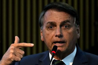 Brazil's President Jair Bolsonaro speaks during a ceremony at the Ministry of Citizenship, in Brasilia, Brazil, Monday, Aug. 2, 2021. Bolsonaro once again mentioned in his speech the existence of fraud in the Brazilian electoral system. The electoral court has rebuffed his claims as baseless, saying the system is trustworthy and there are several means of checking results. (AP Photo/Eraldo Peres)