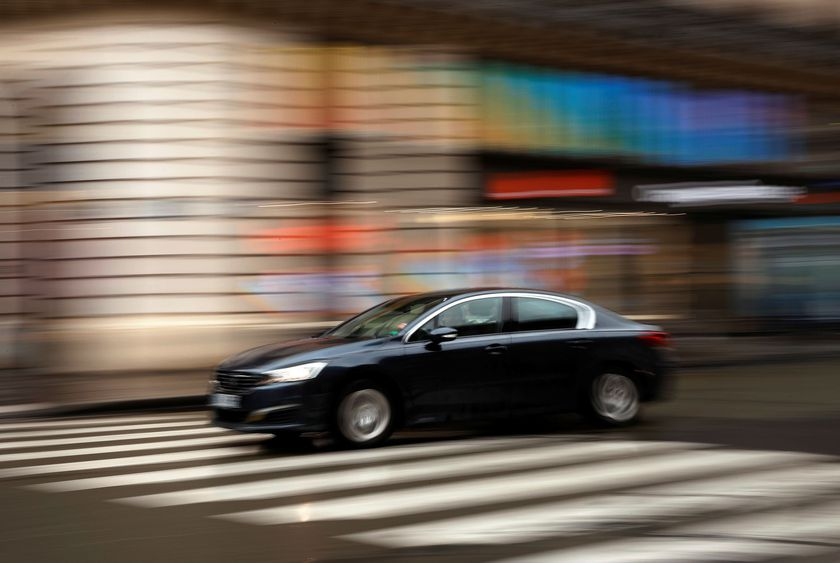 A ride-hailing driver, known in France as VTC, drives in central Paris