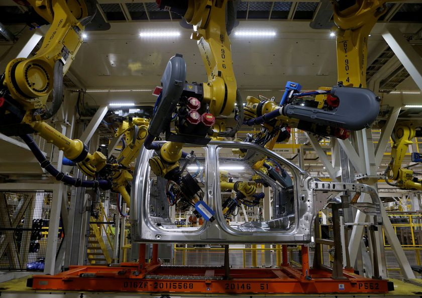 FILE PHOTO: File photo of the aluminium cab of the then all-new 2015 F-150 pick-up truck moves down the robot assembly line at the Ford Rouge Center in Dearborn, Michigan