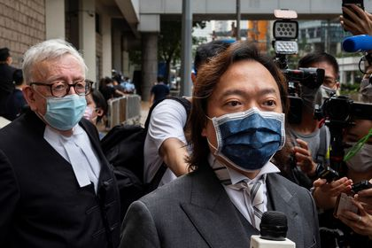 Hong Kong (China), 30/07/2021.- Senior Counsel Clive Grossman (L) and lawyer Lawrence Lau (C) who are representing Tong Ying-kit, speak to the media outside the High Court in Hong Kong, China, 30 July 2021. Tong Ying-kit, 24, was given a nine-year prison sentence for secession and terrorism under the Beijing-imposed national security law for riding his motorcycle into three police officers while carrying a flag that called for the city's liberation last year. (Terrorismo) EFE/EPA/MIGUEL CANDELA