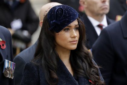 """FILE - In this Thursday, Nov. 7, 2019 file photo Meghan the Duchess of Sussex stands after she and her husband Britain's Prince Harry placed a Cross of Remembrance as they attend the official opening of the annual Field of Remembrance at Westminster Abbey in London. The Duchess of Sussex has revealed that she had a miscarriage in July. Meghan described the experience in an opinion piece in the New York Times on Wednesday. She wrote: """"I knew, as I clutched my firstborn child, that I was losing my second."""" The former Meghan Markle and husband Prince Harry have a son, Archie, born in 2019. (AP Photo/Matt Dunham, File)"""