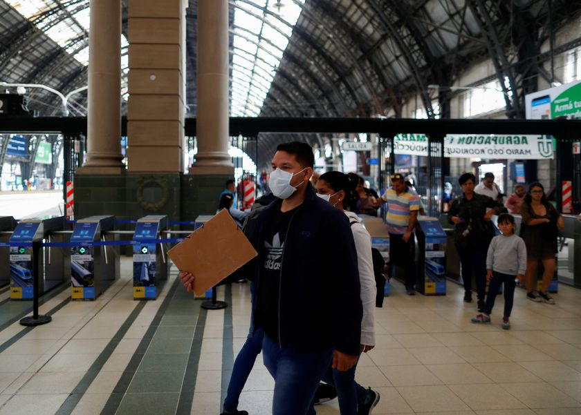A man wearing a face mask as a preventive measure against the coronavirus outbreak walks at the Retiro train station, in Buenos Aires