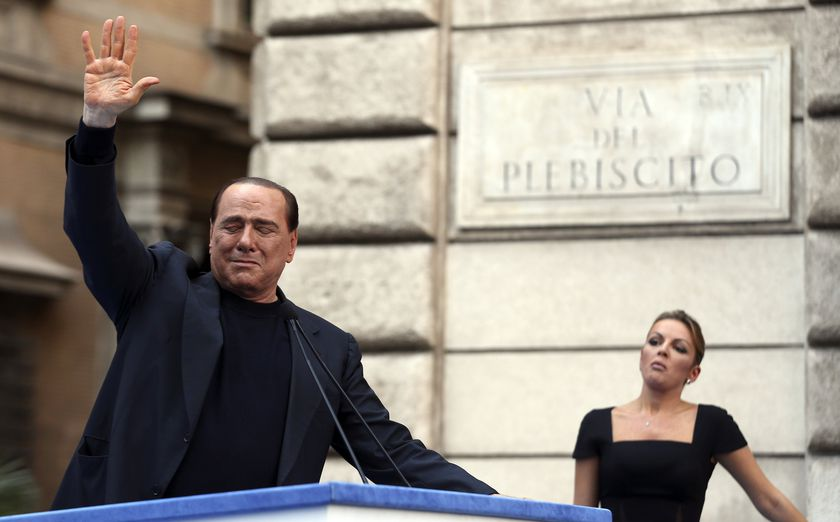 RNPS - PICTURES OF THE YEAR 2013 - Former Italian Prime Minister Silvio Berlusconi waves to supporters as his girlfriend Francesca Pascale looks on during a rally to protest his tax fraud conviction, outside his palace in central Rome August 4, 2013. Tensions in Italy's squabbling coalition heightened ahead of a rally by supporters of Berlusconi in Rome in protest at a tax fraud conviction that threatens his future in politics and the fragile government.   REUTERS/Alessandro Bianchi   (ITALY - Tags: POLITICS CIVIL UNREST TPX)