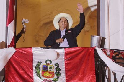 Peru's presidential candidate Pedro Castillo gestures to supporters the day after a run-off election, in Lima, Peru June 7, 2021. REUTERS/Sebastian Castaneda