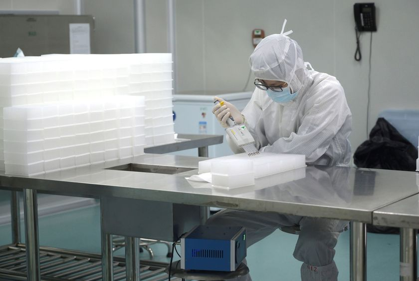 Technician works in a laboratory for manufacturing testing kits for the new coronavirus at a medical laboratory company Da An Gene Co in Guangzhou, Guangdong