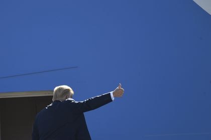 President Donald Trump gestures from the top of the steps as he boards Air Force One at Andrews Air Force Base in Md., Wednesday, July 29, 2020. Trump is heading to Texas and will shift focus to American energy dominance during a stop that will include his first visit to an oil rig. (AP Photo/Susan Walsh)