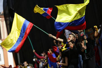 12 May 2021, Colombia, Bogota: Demonstrators wave Colombian flags during a protest against the government of Colombian President Ivan Duque Marquez. Photo: Sergio Acero/colprensa/dpa
