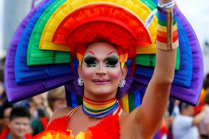 [A participant takes part in the annual Christopher Street Day (CSD) Gay Pride parade, in Cologne]