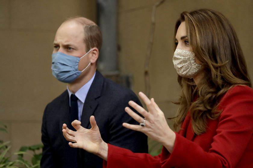 Britain's Prince William and his wife Kate the Duchess of Cambridge meet medical staff as they visit St. Bartholomew's Hospital in London, to mark the launch of the nationwide 'Hold Still' community photography project, Tuesday, Oct. 20, 2020. The Duke and Duchess of Cambridge on Tuesday met a small number of staff from the hospital, including pharmacist and photographer Joyce Duah and the two pharmacy technician colleagues she photographed writing on their PPE as they put it on, in a photograph that was selected to be in the set of 100 images taken during the coronavirus lockdown. (AP Photo/Matt Dunham, Pool)