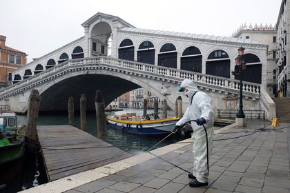 A worker sanitises the Rialto Bridge as a measure against the coronavirus disease (COVID-19) in Venice