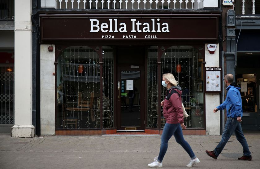 People walk by a Bella Italia restaurant in Chester