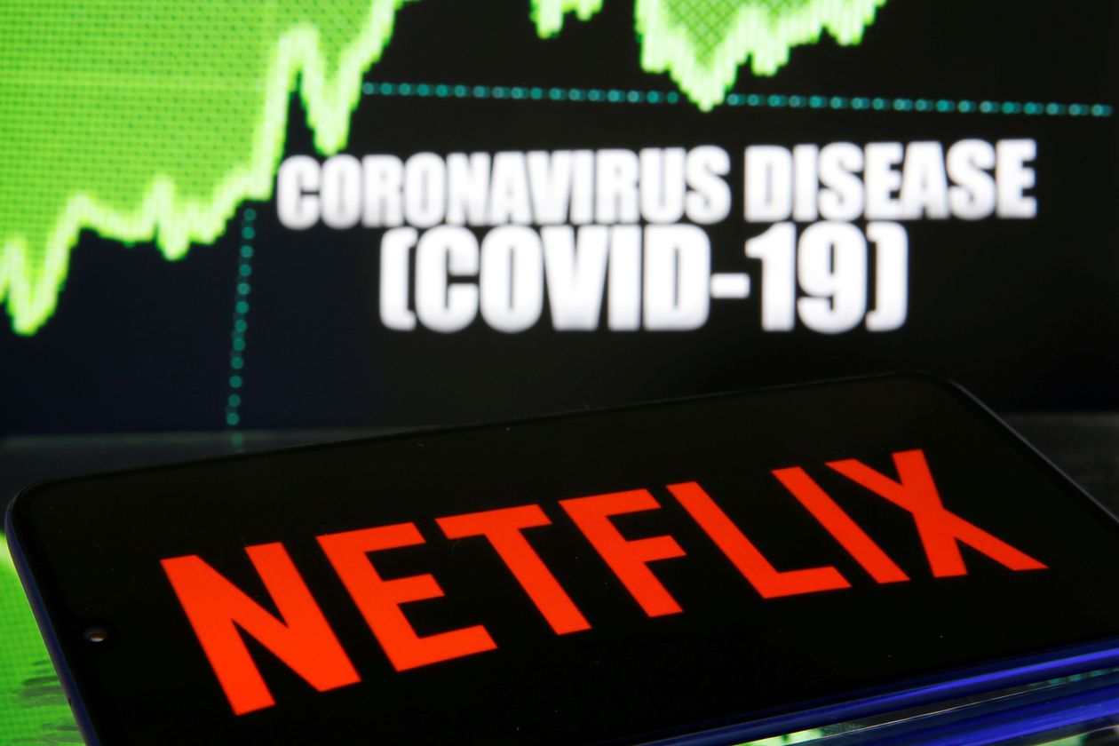 FILE PHOTO: Netlix logo is seen in front of diplayed coronavirus disease (COVID-19)