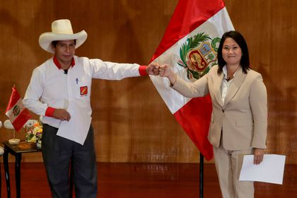 """FILE PHOTO: Peruvian presidential candidates Pedro Castillo and Keiko Fujimori, who will face each other in a run-off vote on June 6, gesture after signing a """"Pact for Democracy,"""" in Lima, Peru May 17, 2021. REUTERS/Sebastian Castaneda/File Photo"""