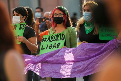 """A woman holds a banner which reads """"Free abort"""" during a protest to celebrate the decision of the Supreme Court of Justice of the Nation (SCJN) that declared the criminalization of abortion as unconstitutional, in Saltillo, Mexico September 7, 2021. REUTERS/Daniel Becerril"""