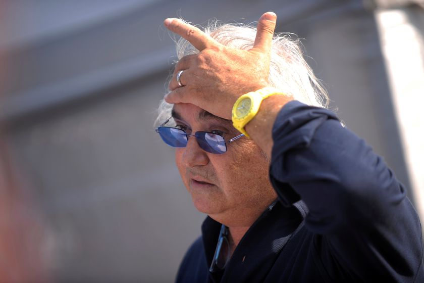 FILE PHOTO: Former Renault F1 principal Flavio Briatore gestures in the paddock after the qualifying session of the Italian F1 Grand Prix at the Monza circuit