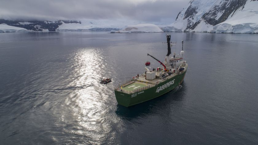 A submarine being launched from Greenpeace ship the Arctic Sunrise outside the coast off Brabant Island, Palmer Archipelago, Antarctic.