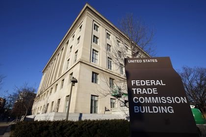 FILE - This Jan. 28, 2015, file photo, shows the Federal Trade Commission building in Washington. The Federal Trade Commission has for the first time banned a company that makes so-called stalkerware — software used to surreptitiously track a cellphone user's activities and location — from continuing in the surveillance app business. The action Wednesday, Sept. 1, 2021, applies to the marketer of SpyFone, Puerto Rico-based Support King LLC, and its CEO, Scott Zuckerman. (AP Photo/Alex Brandon, File)