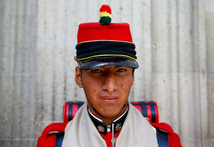 A member of Bolivia's presidential guard stands outside the presidential palace in La Paz