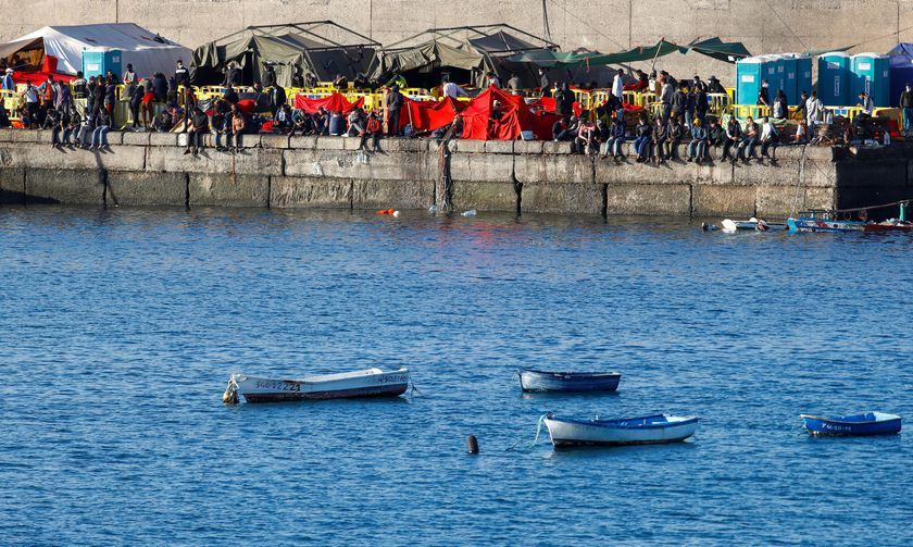 Migrants rest after being rescued by coast guards or reached the island by their own means, in the Arguineguin harbour, on the island of Gran Canaria, Spain November 20, 2020. REUTERS/Borja Suarez